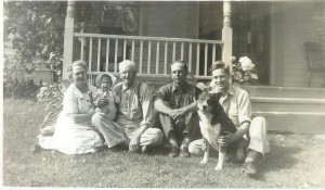 Grandma, me, Grandpa, Uncle Edward, Dad by front porch.