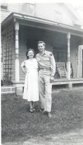 Mom and Dad standing in front of the stoop (10 days before my birth).