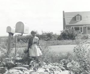 Standing by the mailboxes a few years earlier. Kill's house in background.