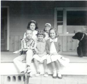 On our front porch. Front: David, Karen (Kill's younger sister), Connie Back: Kathy, me, Wolfy
