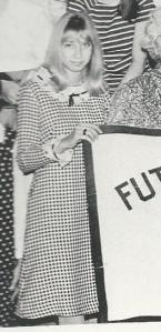 Yearbook photo of my dress while holding a Future Homemakers of America banner.